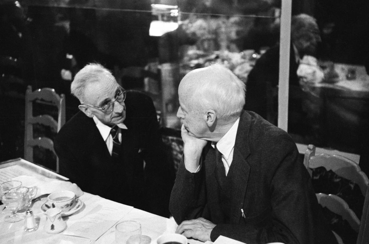 A candid shot of Muste and Thomas in conversation at the awards banquet.