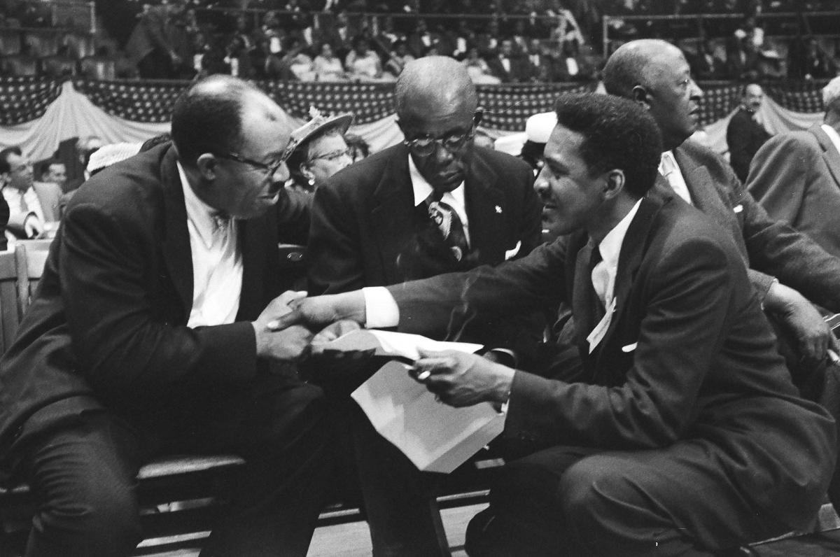 Bayard Rustin (R), who served as WRL's Executive Secretary from 1953 to 1965, greets Dr. T.R.M Howard, one of the featured speakers at the rally.