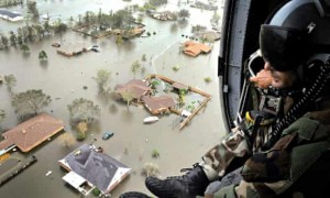 Military Helicopter Pilot overlooks flooded town