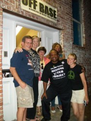 Tom Palumbo, Cindy Sheehan, Connie Hannah, Jame Bailey, Doreen Lake, and Jen St.Clair outside OffBase during the Benefit with Friends gathering last summer. By Ann Williams.