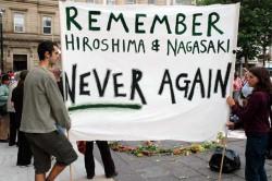 Banner: Remember Hiroshima & Nagasaki: Never Again