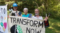 Sister Megan, Greg Boertje-Obed, and Michael Walli with Transform Now banner